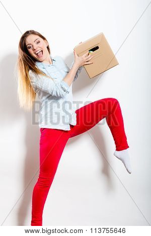 Happy Woman Moving Into House Carrying Box.