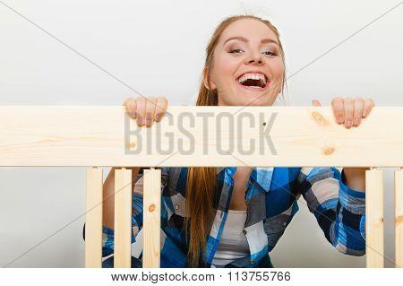 Woman Assembling Wooden Furniture. Diy.