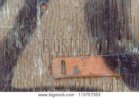 Old Wooden Door With Rusty Red Hinge