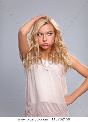 Young emotional woman, isolated on gray background