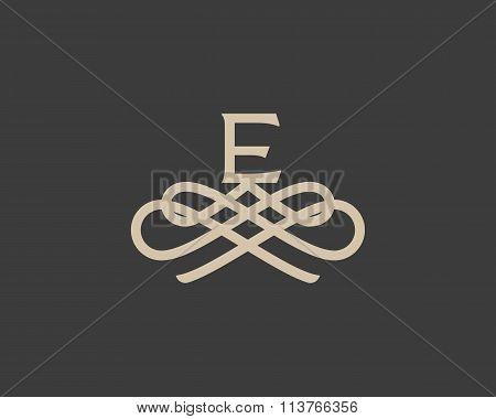 Abstract monogram elegant flower logo icon design. Universal creative premium letter E initials orna
