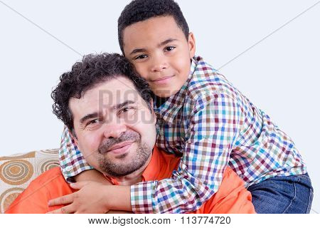 Cheerful Child Hugging Father