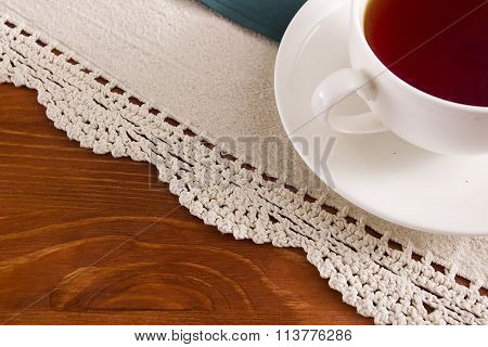 Background With Openwork Napkin And Cup Of Tea