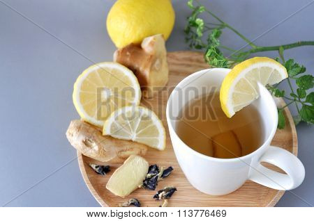 Ginger Tea Cup On Wooden Plate