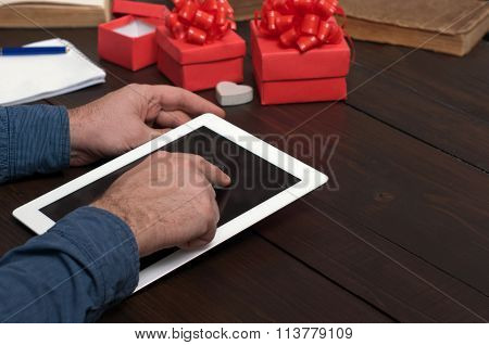 Man Is Shopping Via The Internet Presents