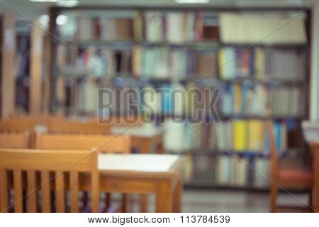 Bookshelf And Table Desk In Library, Education Abstract Blur Defocused Background