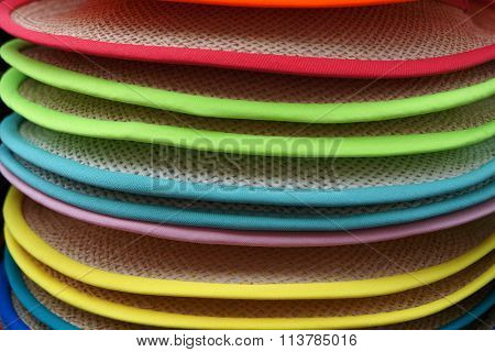 Colorful brims of hats stack.