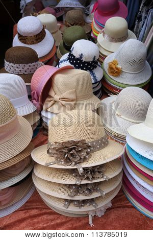 Decorated ladies' hats for sale.