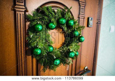 Christmas Wreath On  Brown Wooden Door