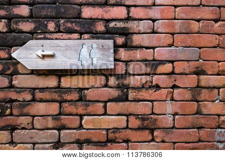 Restroom Sign On The Brick wall