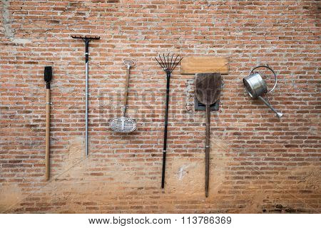 Farmer Instrument Tool Hanging On The Brickwall