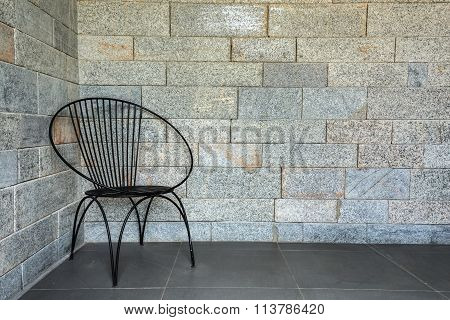 Chair With Space With The Brickwall In The Background