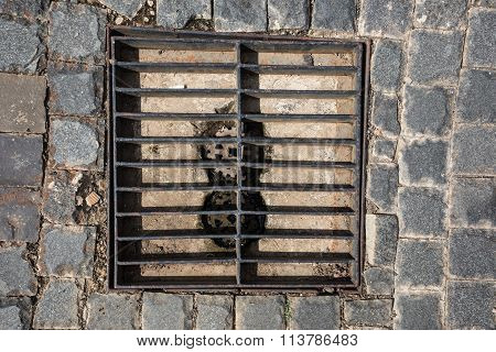 Rectangular Sewer With A Rust And Holes