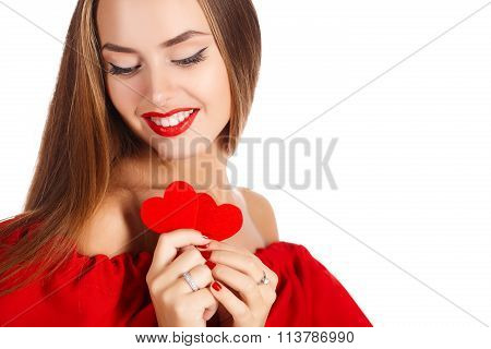 Portrait of Beautiful gorgeous woman with glamour bright makeup and red heart in hand