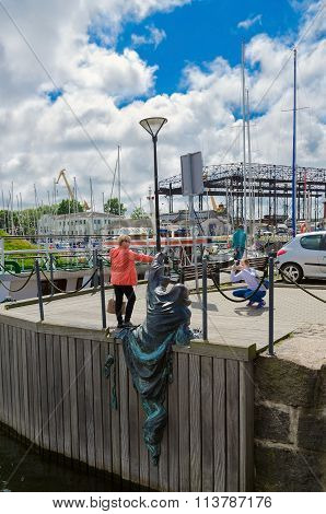 Tourists Are Photographed Near Sculpture Black Ghost, Klaipeda, Lithuania