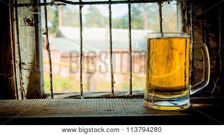 Glass Of Fresh Beer On Wooden Shelf. On The Background Of An Old Window.