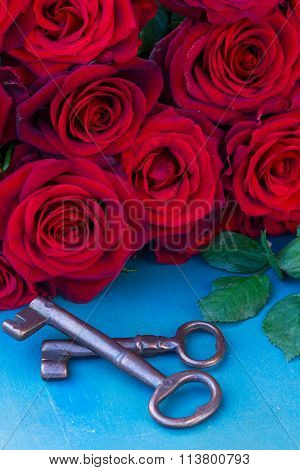red roses with two keys