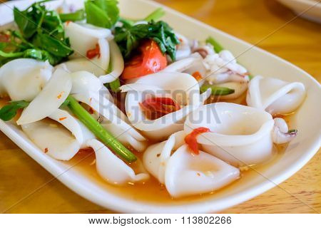 Asian Spicy Squid Salad On White Plate