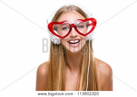 Girl in headphones and heart shaped glasses