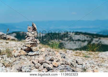 Cairn On Top Of A Mountain