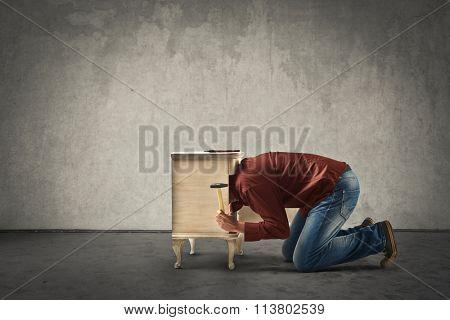 Man fixing furniture