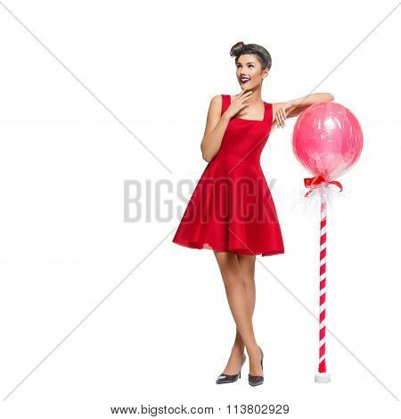 Girl in red dress with huge lollipop