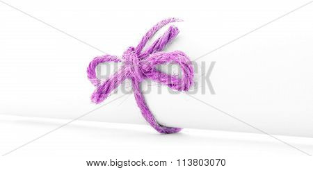 Handmade Pink Rope Bow Tied On White Message Roll Isolated