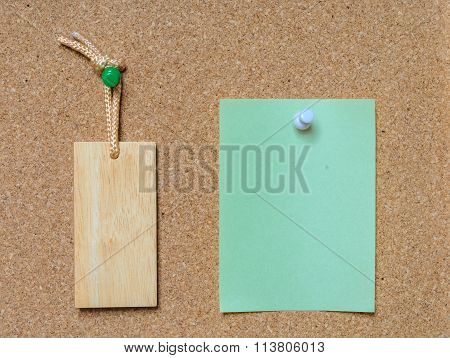 Blank Wooden Tag And Paper On Cork Board