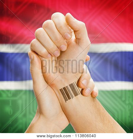 Barcode Id Number On Wrist And National Flag On Background - Gambia