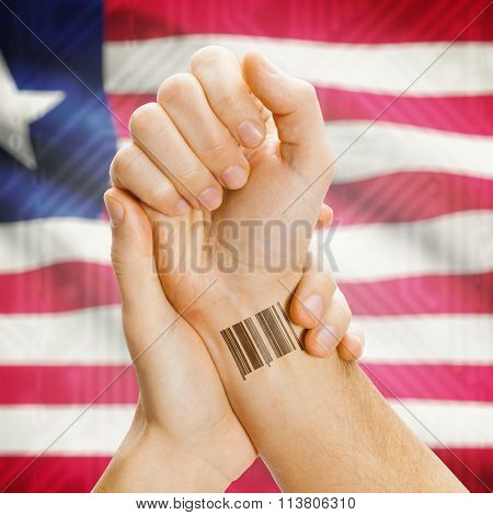 Barcode Id Number On Wrist And National Flag On Background - Liberia