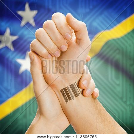 Barcode Id Number On Wrist And National Flag On Background - Solomon Islands