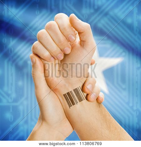 Barcode Id Number On Wrist And National Flag On Background - Somalia