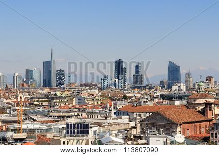 View of Milan skyline with mountains in the background