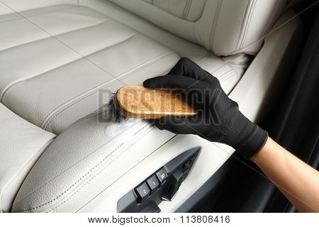 Car Service. Worker Washing Of Interior By A Brush