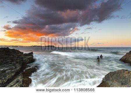 Currumbin Rock sunset surfing