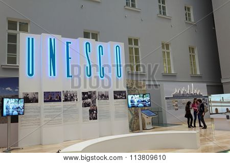 ST. PETERSBURG, RUSSIA - DECEMBER 16, 2015: People in the exhibition dedicated to 25th anniversary of including the Russian sites in UNESCO World Heritage list during 4th St. Petersburg Cultural Forum
