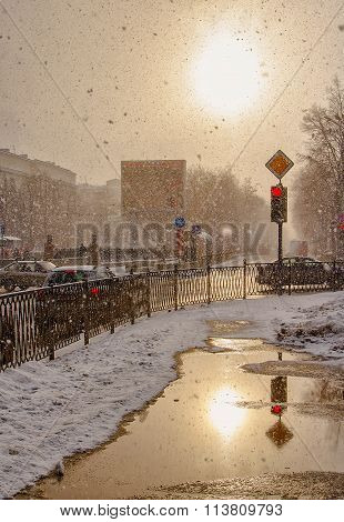 Heavy snowfall in city with  sun