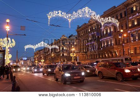 ST. PETERSBURG, RUSSIA - DECEMBER 27, 2015: Traffic on the night Nevsky avenue decorated for Christmas and New Year celebrations. It is the main avenue of the city