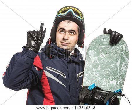 Male snowboarder with the board.