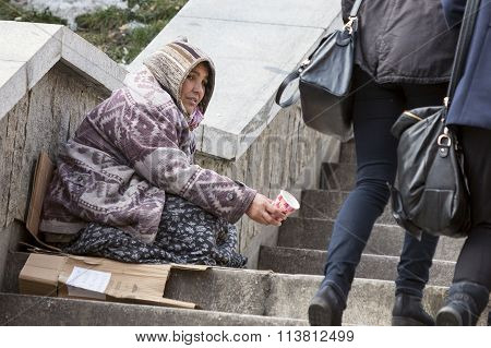 Homeless Gypsy Woman Begging For Money