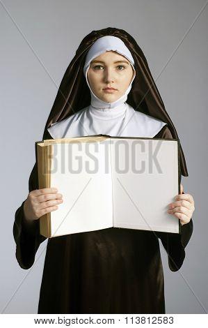 Nun With Book