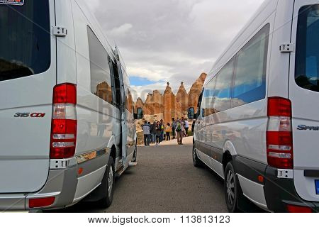 Cappadocia., Turkey - April 29, 2014: Tourists Came Out Of Tour Buses In The Red Valley.