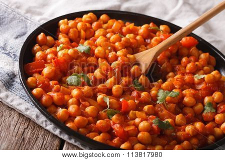 Indian Chickpeas In Tomato Sauce With Spices Close-up. Horizontal