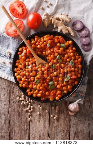 Indian Chana Masala With Ingredients. Vertical Top View