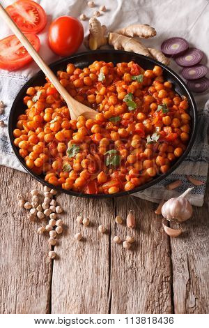 Indian Cuisine: Chana Masala With Ingredients Close-up. Vertical