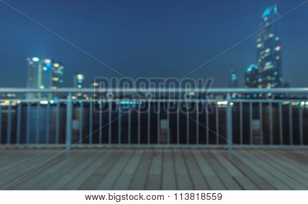 Blurred Abstract Background Of Riverwalk With Cityscape Night Light