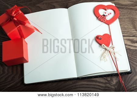Valentine Day. Two Gift In Red Box And Two Hearts On Note Congratulations. Wood