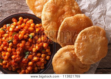 Indian Chana Masala And Puri Bread Close-up. Horizontal Top View