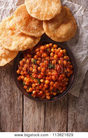 Delicious Indian Chana Masala And Puri. Vertical Top View