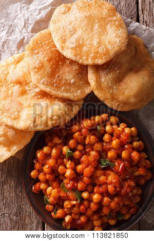 Indian Chana Masala And Puri Bread Close-up. Vertical Top View